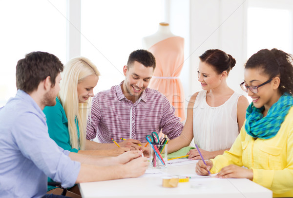 smiling fashion designers working in office Stock photo © dolgachov