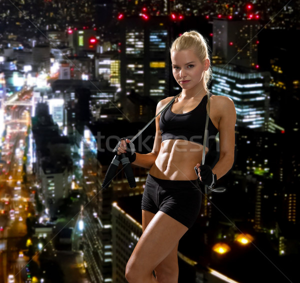 sporty woman with skipping rope Stock photo © dolgachov