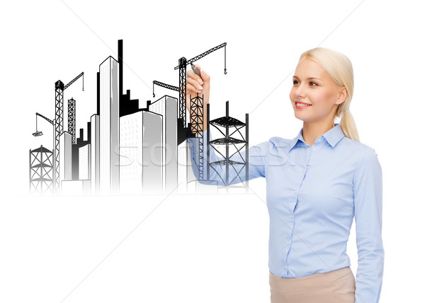 Stock photo: smiling businesswoman drawing construction site
