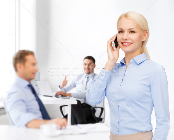 Młodych uśmiechnięty kobieta interesu smartphone działalności technologii Zdjęcia stock © dolgachov