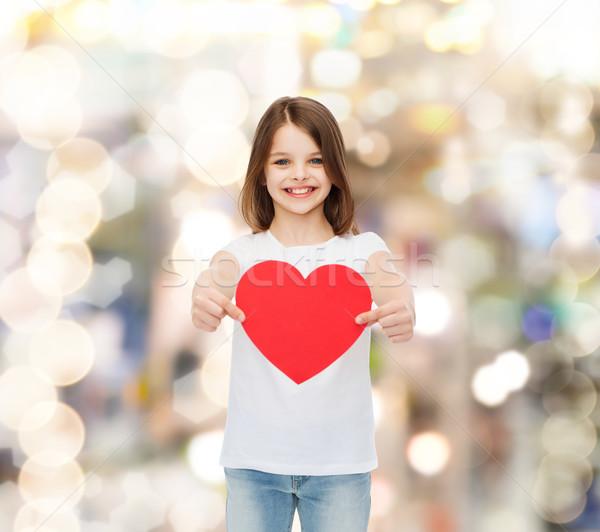 Gyönyörű kislány ül asztal gyermekkor szeretet Stock fotó © dolgachov