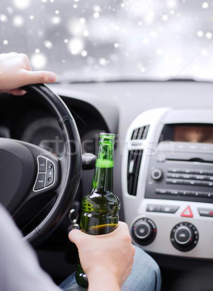 close up of man drinking alcohol while driving car Stock photo © dolgachov