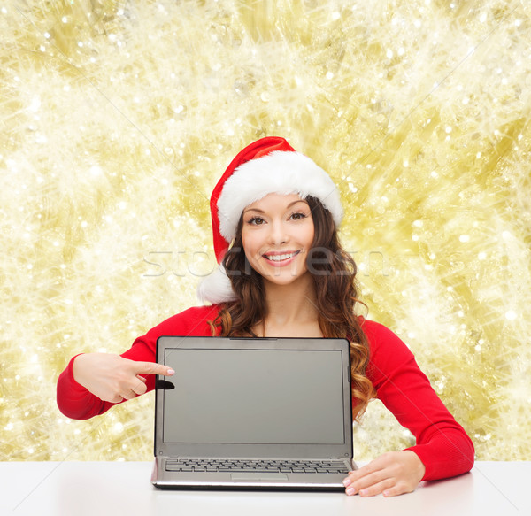 smiling woman in santa helper hat with laptop Stock photo © dolgachov