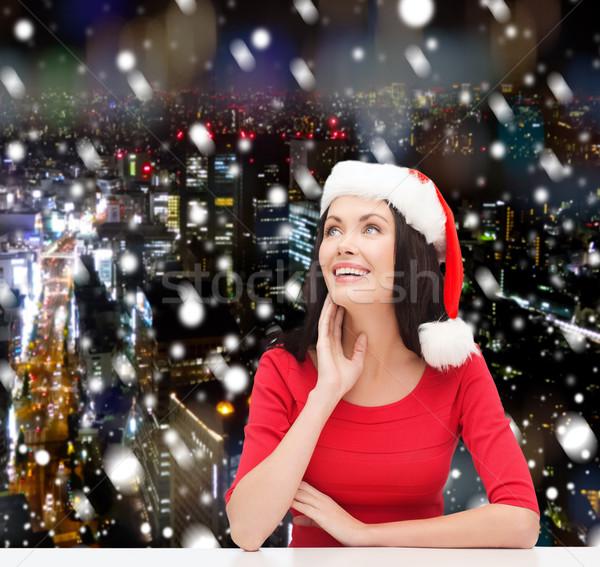 Gülümseyen kadın yardımcı şapka Noel kış Stok fotoğraf © dolgachov