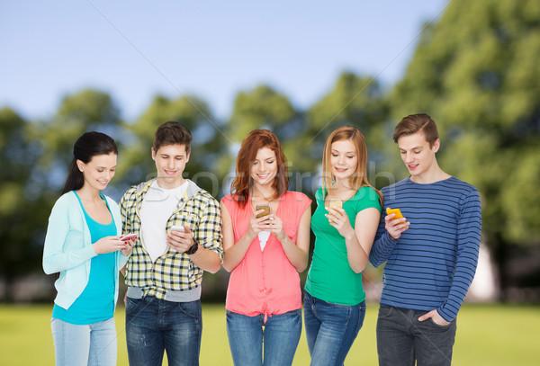 улыбаясь студентов образование современных технологий Сток-фото © dolgachov