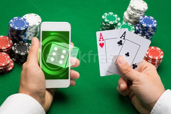 Stok fotoğraf: Kumarhane · oyuncu · kartları · cips · çevrimiçi