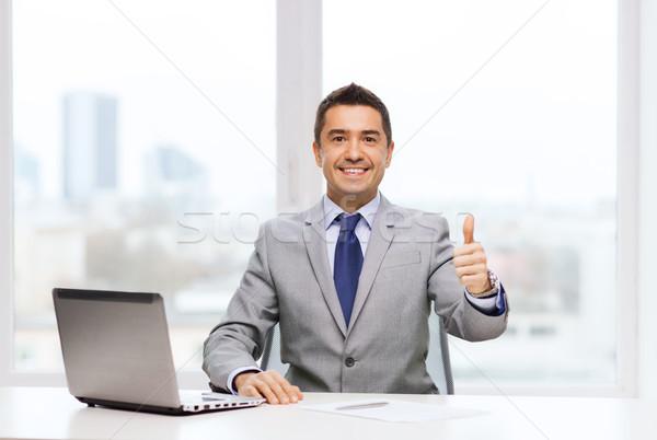 Empresario de trabajo portátil oficina gente de negocios tecnología Foto stock © dolgachov