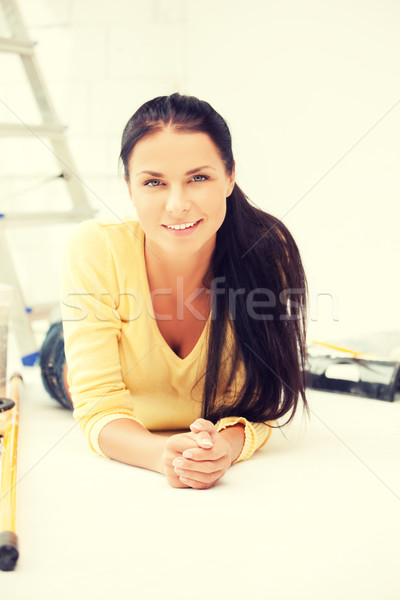 Stock photo: lovely housewife making repairing works