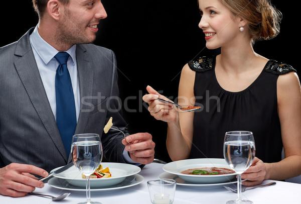 close up of couple talking at restaurant Stock photo © dolgachov