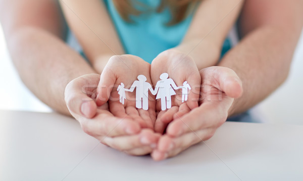 close up of man and girl with cupped hands at home Stock photo © dolgachov