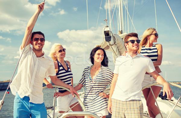Mosolyog barátok vitorlázik jacht vakáció utazás Stock fotó © dolgachov