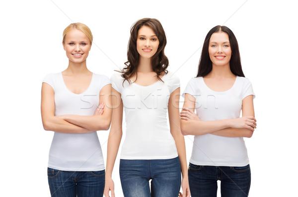group of smiling women in blank white t-shirts Stock photo © dolgachov