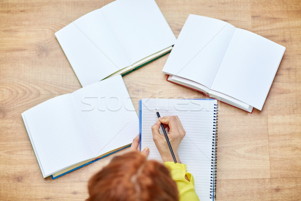 close up of female hands writing to notebook Stock photo © dolgachov