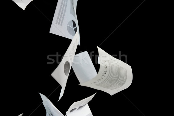 business papers falling down over black background Stock photo © dolgachov