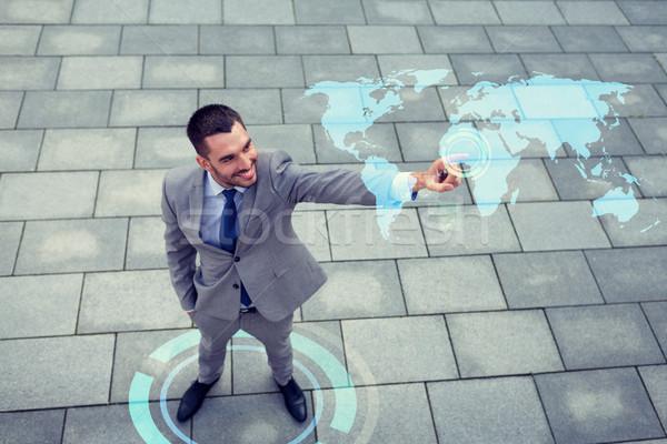 улыбаясь бизнесмен Мир карта проекция развития Сток-фото © dolgachov