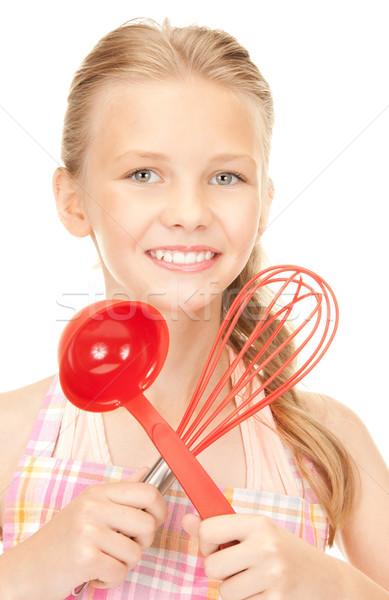 Piccolo casalinga rosso mestolo foto ragazza Foto d'archivio © dolgachov