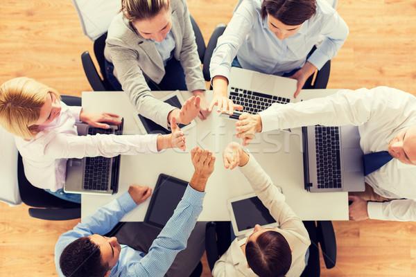 Equipo de negocios máximo de cinco gente de negocios tecnología Foto stock © dolgachov