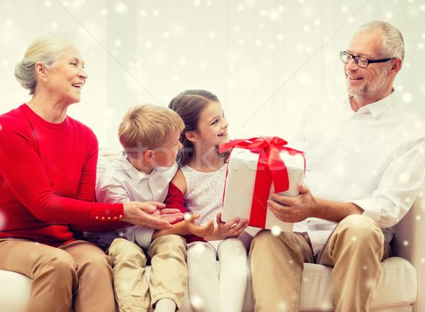 улыбаясь дедушка и бабушка внучата подарок семьи праздников Сток-фото © dolgachov
