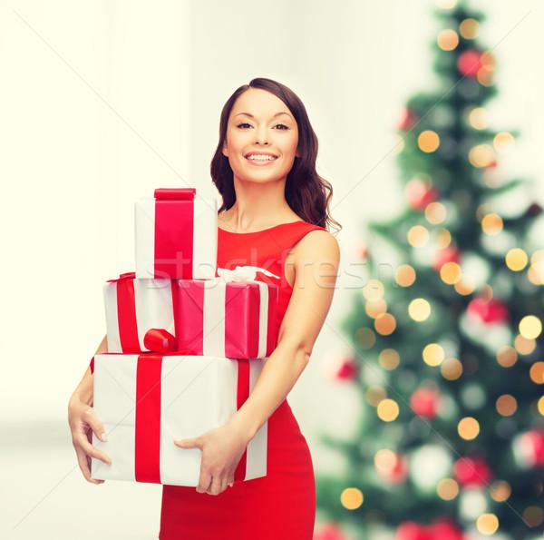 笑顔の女性 赤いドレス 多くの ギフトボックス クリスマス クリスマス ストックフォト © dolgachov