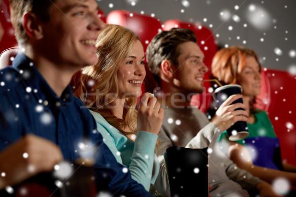 happy friends with popcorn and drinks in cinema Stock photo © dolgachov