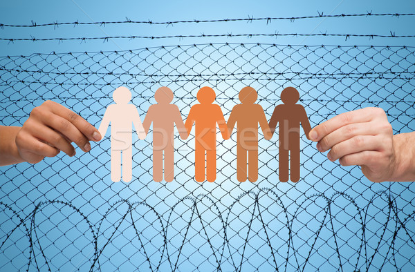 hands holding people pictogram over barb wire Stock photo © dolgachov