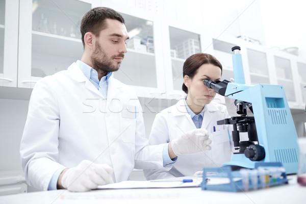 Cientistas clipboard microscópio lab ciência química Foto stock © dolgachov