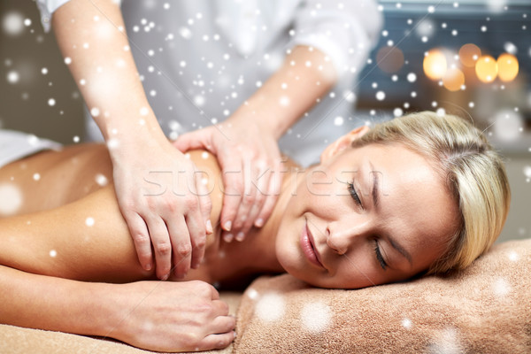 close up of woman having back massage in spa Stock photo © dolgachov