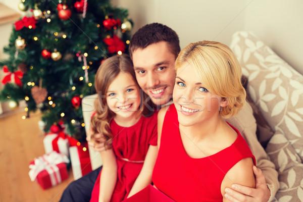 Boldog család otthon család karácsony karácsony boldogság Stock fotó © dolgachov