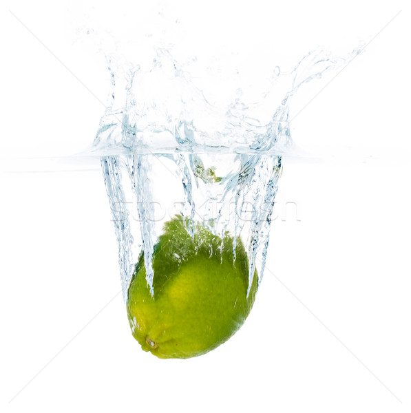 lime falling or dipping in water with splash Stock photo © dolgachov