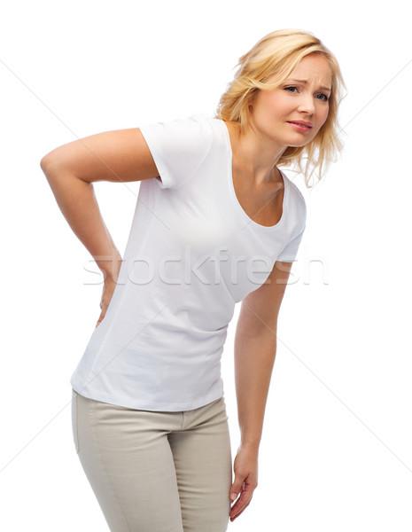 Nieszczęśliwy kobieta cierpienie ból w krzyżu ludzi opieki zdrowotnej Zdjęcia stock © dolgachov