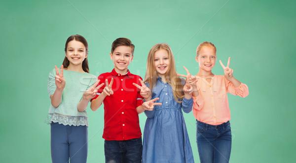 Ninas paz muestra de la mano infancia Foto stock © dolgachov