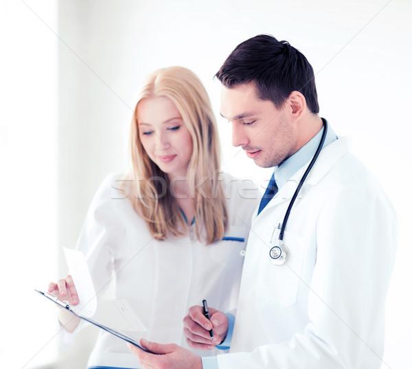 two doctors writing prescription Stock photo © dolgachov