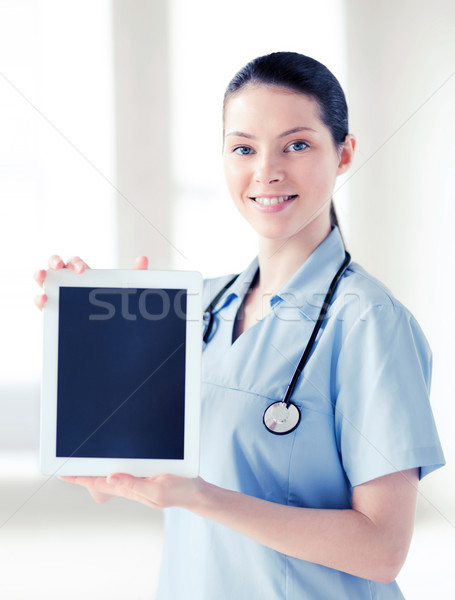 female doctor with tablet pc Stock photo © dolgachov