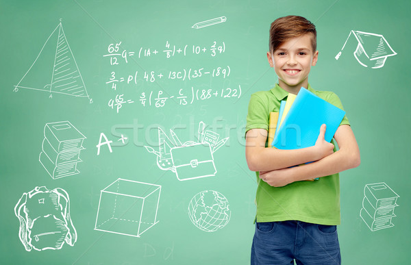 happy student boy with folders and notebooks Stock photo © dolgachov