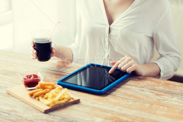 close up of woman with tablet pc and fast food Stock photo © dolgachov