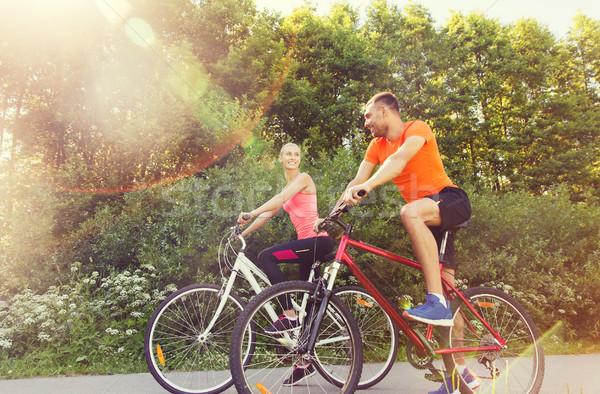 happy couple riding bicycle outdoors Stock photo © dolgachov
