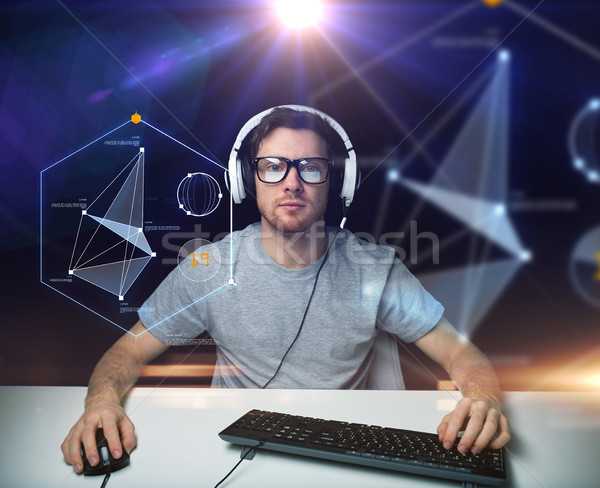 man in headset with computer virtual projections Stock photo © dolgachov