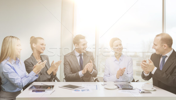 business team with laptop clapping hands Stock photo © dolgachov