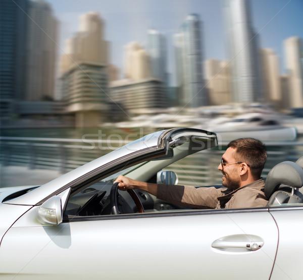 Feliz hombre conducción cabriolé coche ciudad Foto stock © dolgachov