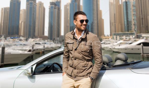 Szczęśliwy człowiek kabriolet samochodu miasta auto Zdjęcia stock © dolgachov