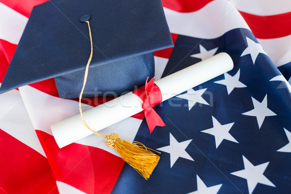 bachelor hat and diploma on american flag Stock photo © dolgachov