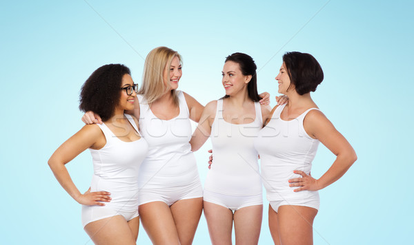 Grupy szczęśliwy inny kobiet biały bielizna Zdjęcia stock © dolgachov