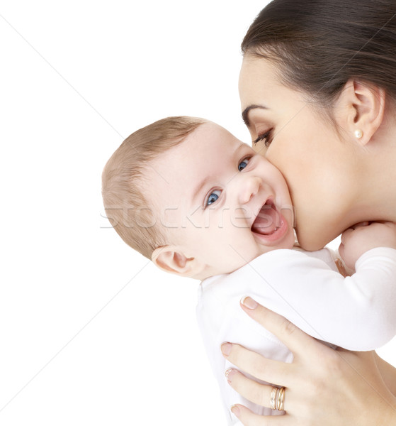 mother kissing adorable baby Stock photo © dolgachov