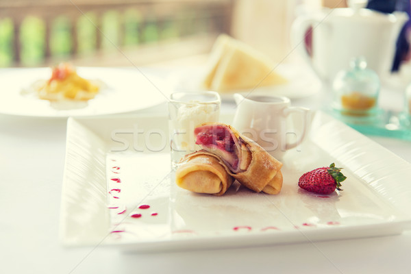 close up of pancakes and honey or jam on plate Stock photo © dolgachov
