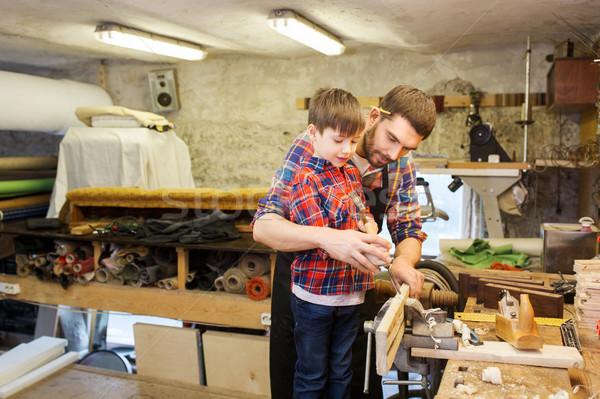 Baba oğul keski çalışma atölye aile marangozluk Stok fotoğraf © dolgachov