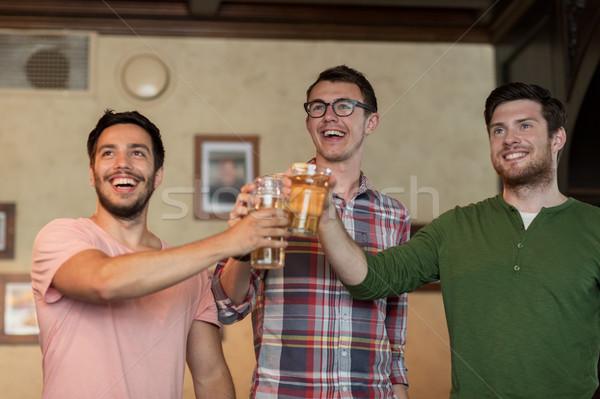 幸せ 男性 友達 飲料 ビール バー ストックフォト © dolgachov