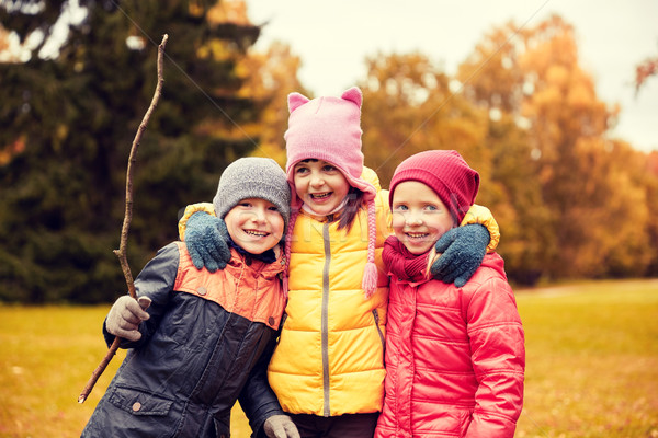 group of happy children hugging in autumn park Stock photo © dolgachov