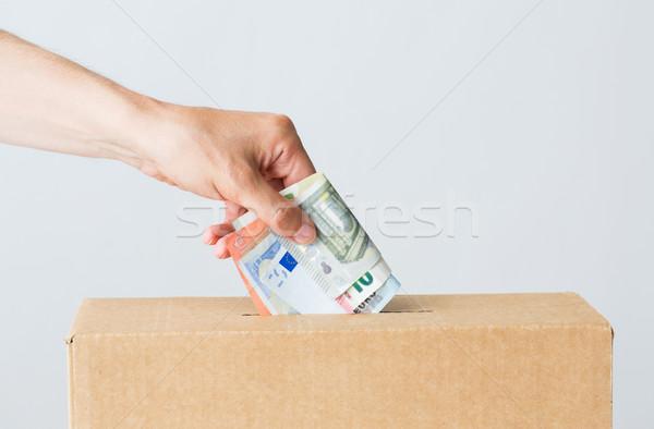 Férfi Euro pénz adomány doboz jótékonyság Stock fotó © dolgachov