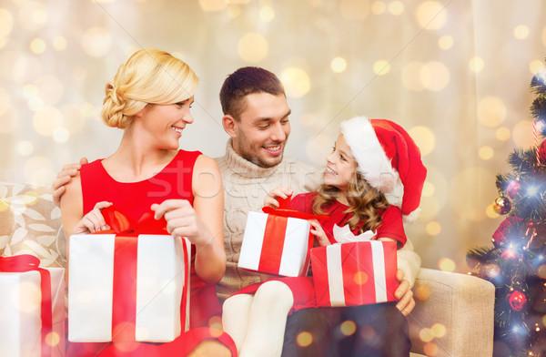 happy family opening gift boxes Stock photo © dolgachov