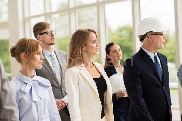 business team in helmets walking along office Stock photo © dolgachov